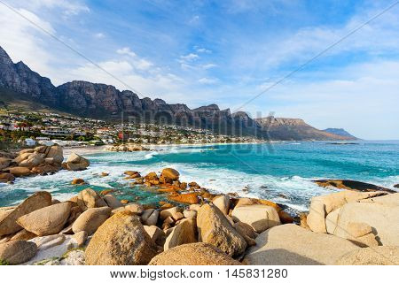 Landscape of beautiful Camps bay in Cape Town with Twelve Apostles mountain range in background