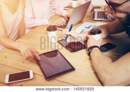 Young Business Team Brainstorming Meeting Process.Coworkers Startup Marketing Project.Creative People Making Great Work Decisions Wood Table.Tablet Graphs Diagram Screen Notebook.Color Filter Effect