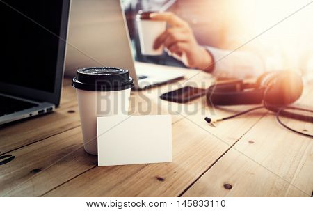 White Blank Business Card Mockup Wood Table Take Away Coffee Cup.Adult Businessman Work Modern Notebook Office Blurred Background.Clean Object Ready Private Corporate Information.Horizontal Mock Up