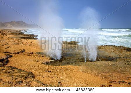 Blow holes at Al Mughsayl beach near Salalah, Oman