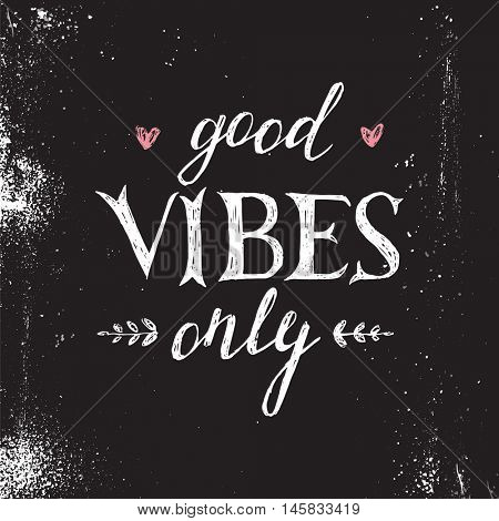 Hand drawn lettering good vibes only on black background