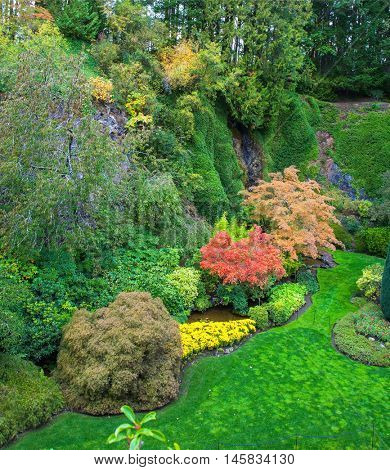 Butchart Gardens - beautiful gardens on Vancouver Island. Flower beds of colorful flowers and walking paths for tourists. The world-famous masterpiece of park architecture