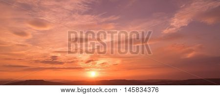 Sunset Scene With Sun Fall And Ray Light, Clouds In Background, Warm Colorful Sky