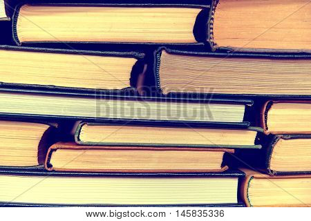 The many old books background. Toned photo