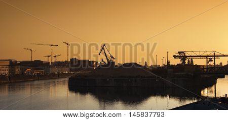 Industrial area Frankfurt Osthafen at dawn toned image