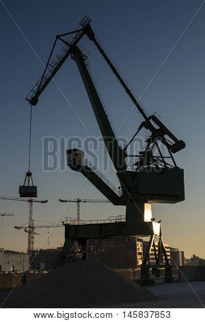 Silhouette of a crane at the harbor - back lit