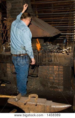 Old Blacksmith At A Shop.