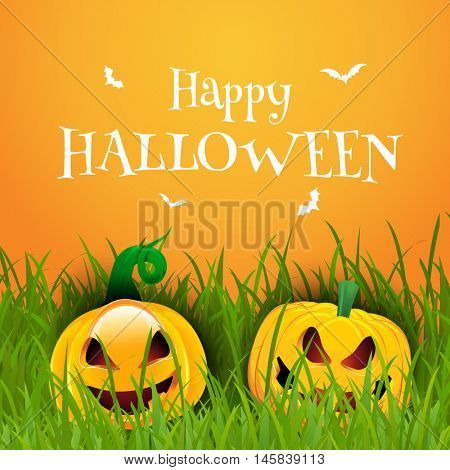 Happy Halloween background with pumpkins nestled in grass