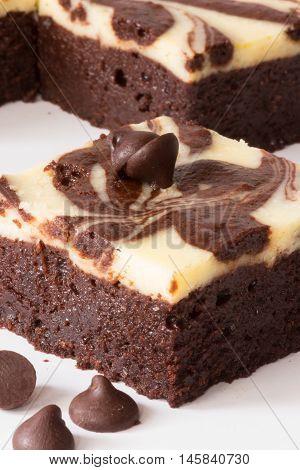 Cutting Of Brownie Cheesecake