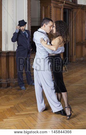 Passionate Tango Dancers Performing While Man Looking At Them