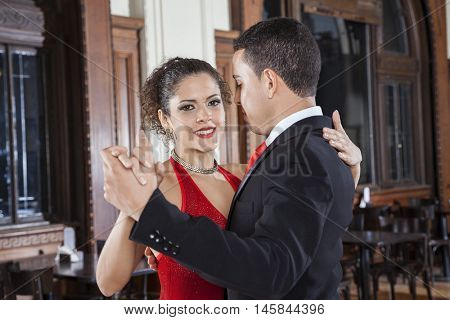 Tango Dancer Performing Gentle Embrace Step With Man