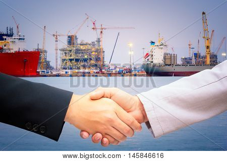 Handshake for port construction agreement of logistics partners.