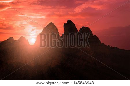 Mountains Silhouette At Sunset Scene With Sun Fall And Ray Light, Clouds In Background