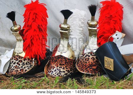 BORODINO MOSCOW REGION - SEPTEMBER 04 2016: Three helmets decorated by leopard print shown at Borodino battle historical reenactment in Russia. Color photo.