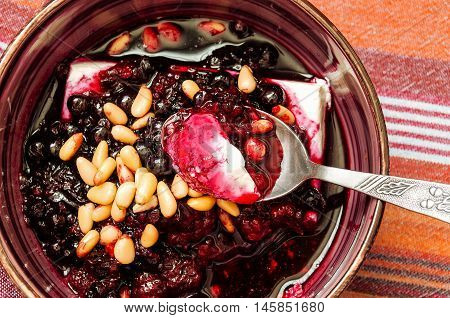 Cottage Cheese With Berry Sauce And Pine Nuts