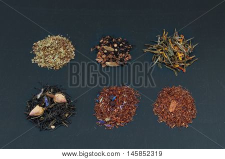 Assortment Of Dried Teas On Dark Background