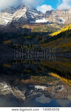 Maroon Bells reflecting in Maroon Lake near Aspen Colorado