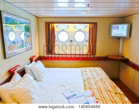 San Juan, Puerto Rico - May 08, 2016: The inside cabin with two portholes at Carnival Cruise Ship Fascination. She is one of 8 sister ships and received a million dollar refurbishment in 2006