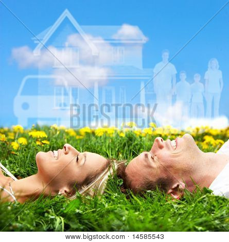 Young couple dreaming about a new car and a house