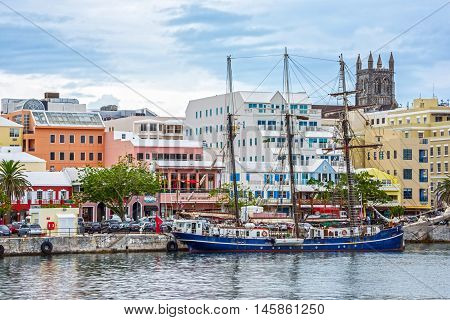 HAMILTON BERMUDA MAY 25 - An old tall ship and colorful buildings are typical of the view on May 25 2016 in HamiltonBermuda.