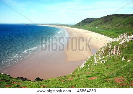 Rhossili Bay, Rhossili, on the Gower Peninsular, West Glamorgan, Wales, UK, which is a popular Welsh coastline attraction of outstanding beauty and a World Heritage Site