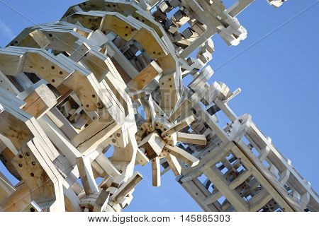 Wooden designer of fine elements bolted on a background of blue sky