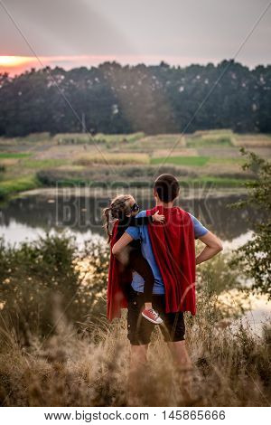 Little Girl With Dad Dressed In Super Heroes, Happy Loving Family