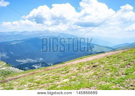 Panoramic landscape of the Pyrenees mountains and fluffy clouds from the peak of Tosa d´Alp, Pyrenees, Girona, Alp, Catalonia, Spain
