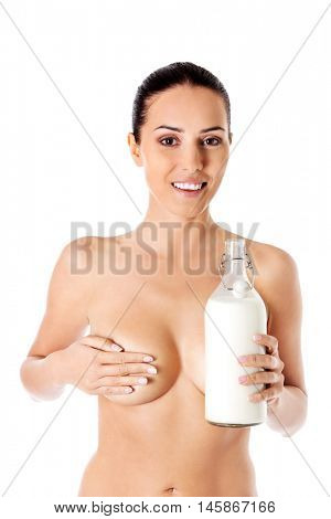 Nude woman is holding a ewer of milk. Spa concept.