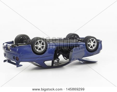 toy car over turn on the white background