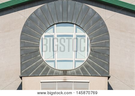 Modern circular windows in a building façade with zinc metal cover.
