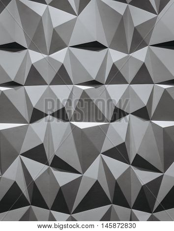abstract wallpaper or geometrical background consisting of black and white geometric shapes: triangles and polygons.