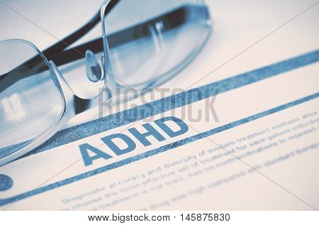 ADHD - Attention Deficit Hyperactivity Disorder - Printed Diagnosis with Blurred Text on Blue Background with Spectacles. Medical Concept. 3D Rendering.