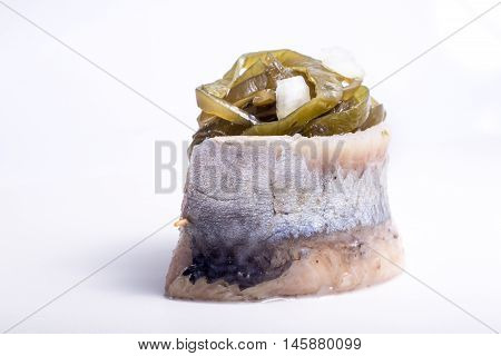 a piece of fish on a white background photo studio isolated herbs meal