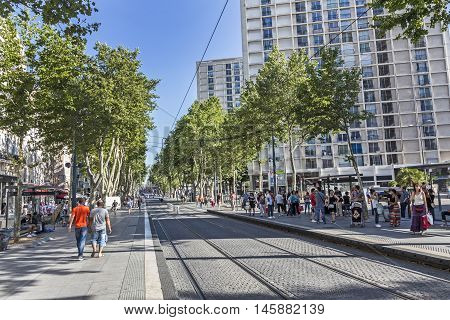 People Wait For The Streetcar In The Town Of Marseilles
