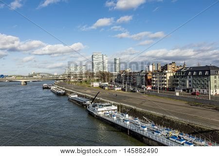 Cologne Skyline With Dome And Bridge And Ships On Pier