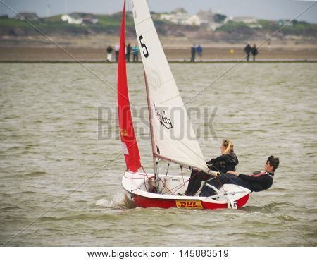 WEST KIRBY, ENGLAND, JUNE 26. The Marine Lake on June 26, 2016, in West Kirby, England. A two-person team races a sailboat in the Marine Lake in West Kirby England.