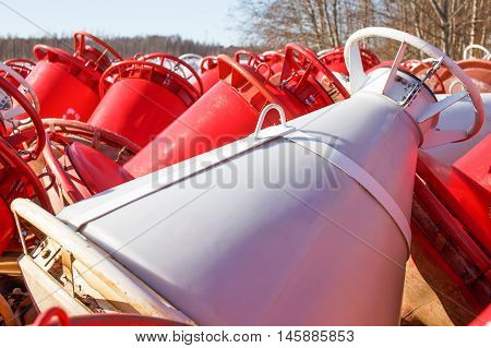red and white buoys. unnavigable period. buoys on the shore in the winter. Closeup