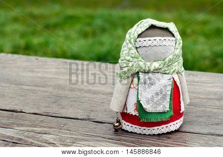 Russian traditional rag doll on nature background
