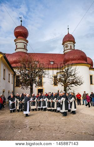 KONIGSSEE, BAVARIA, GERMANY - OCTOBER 4, 2013: Church of St. Bartholomew at Lake K�¶nigssee. Catholic chapel in Baroque style. Monastic Choir performs ritual chants