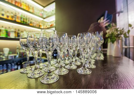 A row of empty wine glasses