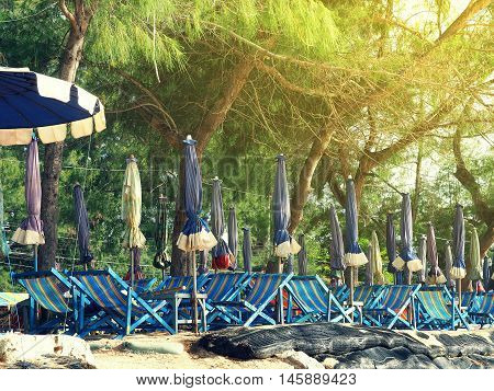 Colorful beach chairs and umbrellas with sunny light for tourism relax in vocation at Cha-Am beach Thailand