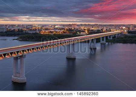 Metro Bridge through Oka River in Nizhny Novgorod on the sunset background.