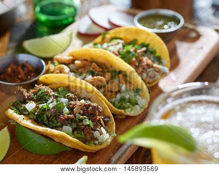 mexican street tacos in yellow tortilla with beef and pork