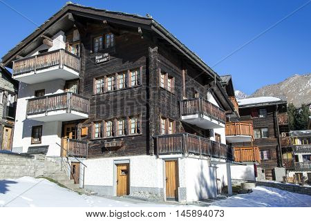 SWITZERLAND, SAAS-FEE, DECEMBER, 26, 2015 - Old wooden house built in 1758, in the charming Swiss resort of Saas-Fee, Switzerland