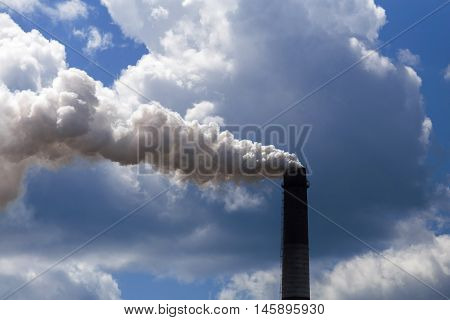 Pipe heavy industry factory emits into the air precipitation, smog and gas, polluting the planet.