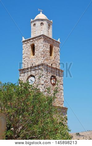 The stone clock tower at Emborio on the Greek island of Halki. The clock has been stopped at four twenty for many years.