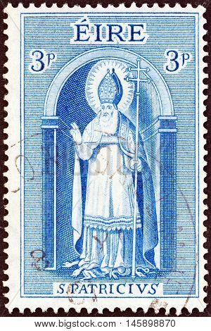 IRELAND - CIRCA 1961: A stamp printed in Ireland issued for the 15th death centenary of St. Patrick shows Saint Patrick, circa 1961.