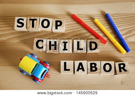 Wooden cubes with space for text with pencils and toy car on wooden background