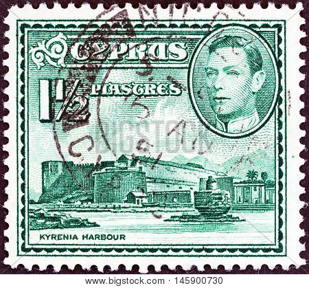 CYPRUS - CIRCA 1938: A stamp printed in Cyprus shows Kyrenia Harbor and King George VI, circa 1938.
